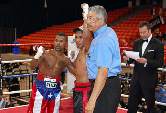 Bustamante is declared the winner after a hard-fought battle