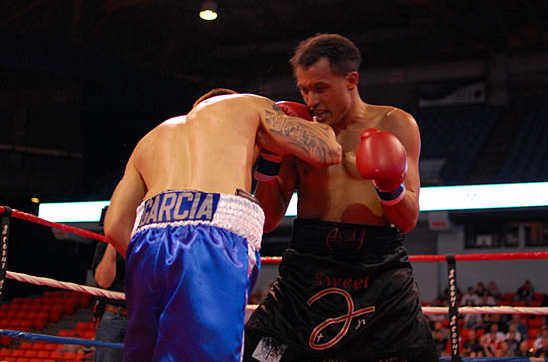 Coverson (R) looks to get in some short punches