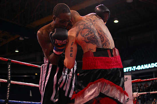 Crouch (R) comes inside Johnson's guard to attack the body