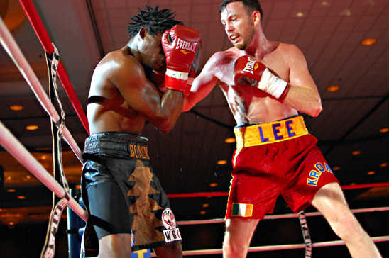 Andy Lee (R) attacks Alex Bunema on the way to victory