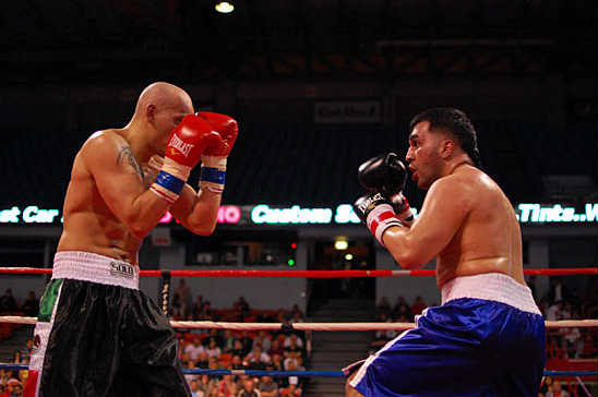 Ninos Abraham (R) looks for an opening against Cesar Martinez
