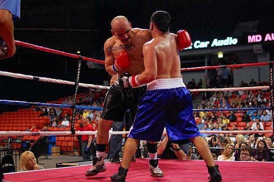 Abraham (R) traps Martinez's arm as Martinez attacks