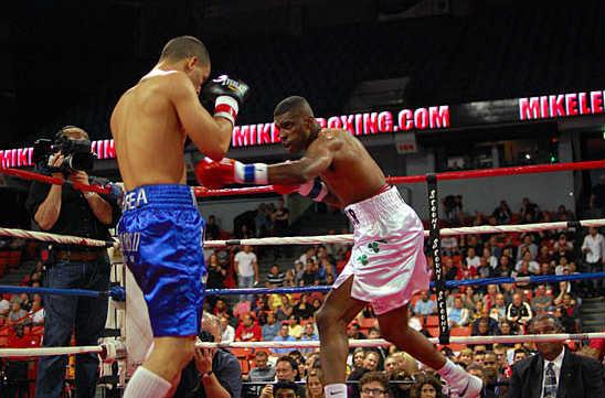 Eric Draper (R) attacks with a jab to Jaime Herrera's body
