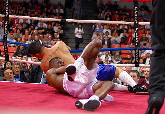 Herrera and Draper go down as Herrera tries to escape a clinch