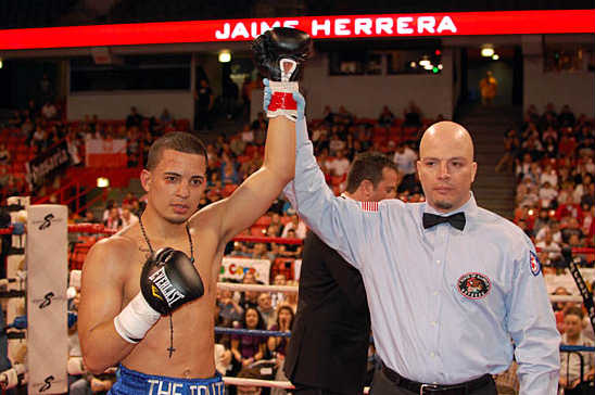 Herrera hears the official announcement of his win