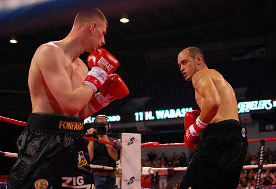 Andrzej Fonfara (L) and Anthony Russell circle each other