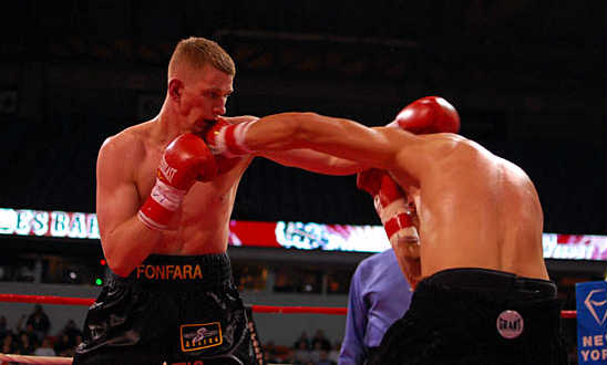 Russell (R) slips a jab from Fonfara to counter