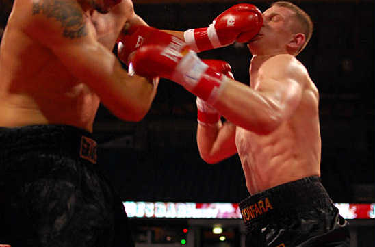 Russell lands a jab as Fonfara (R) moves to attack