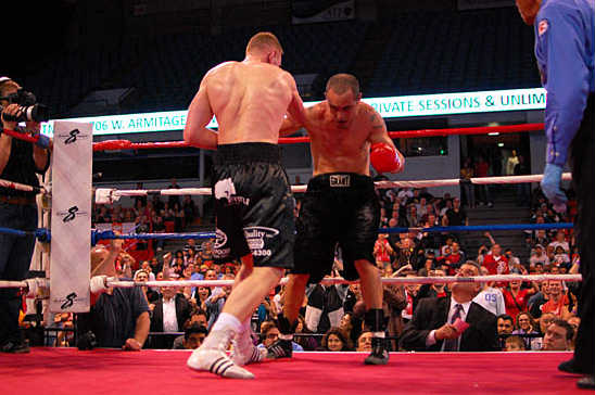 Fonfara (L) drives Russell to the ropes with a straight punch to the body