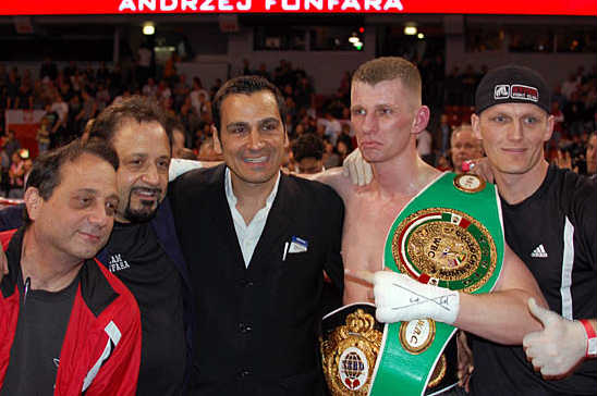 Fonfara celebrates his victory with his team, including 8 Count Promotions' Dominic Pesoli (Center)