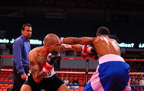 Santiago attacks Holloman's body off a jab