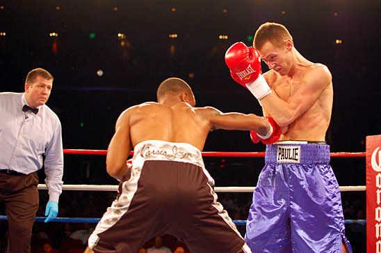 Dwayne Wisdom (L) begins his assault on Paulie Settepani's body