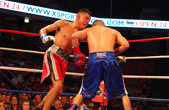 Granados (L) and Gomez slug it out in the eighth round