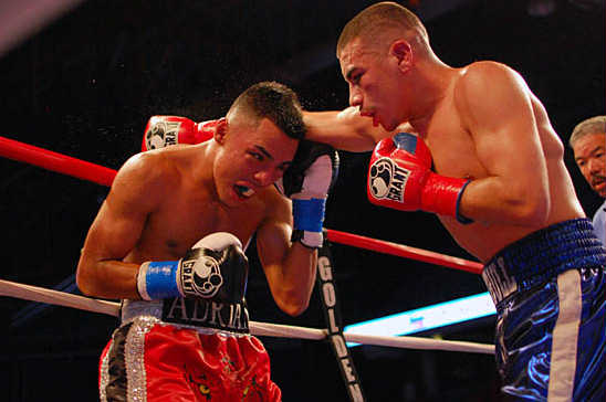 Adrian Granados (L) and Frankie Gomez battle over eight rounds