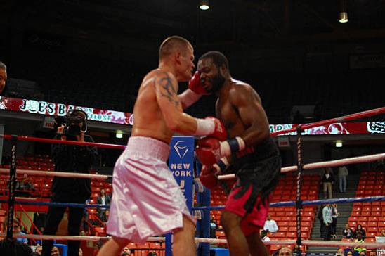 Viktor Polyakov (L) successfully counters Romaro St. Johnson