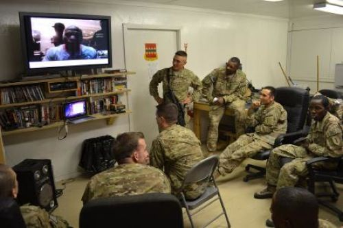 U.S. Army soldiers and boxing enthusiasts from 3rd Brigade Combat Team, 1st Infantry Division, Task Force Duke, talk with five-time World Boxing Council champion Floyd Mayweather Jr. via Skype at Forward Operating Base Salerno Sept. 2 (Photo by Maj. Travis Dettmer).