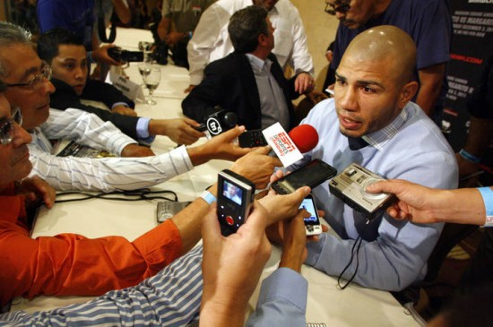 Sept. 22, 2011, Los Angeles,Ca.  ---   Miguel Cotto talks with reporters Thursday in Los Angeles during a public press conference on the world tour to announce his highly-anticipated World Championship rematch against Antonio Margarito , Saturday, December 3, at Madison Square Garden in New York. Promoted by Top Rank, in association with Cotto Promotions, Tornado Promotions, AT&T, and Madison Square Garden, Cotto-Margarito II will be produced and distributed Live by HBO Pay-Per-View®.  --- Photo Credit : Chris Farina - Top Rank,  copyright 2011