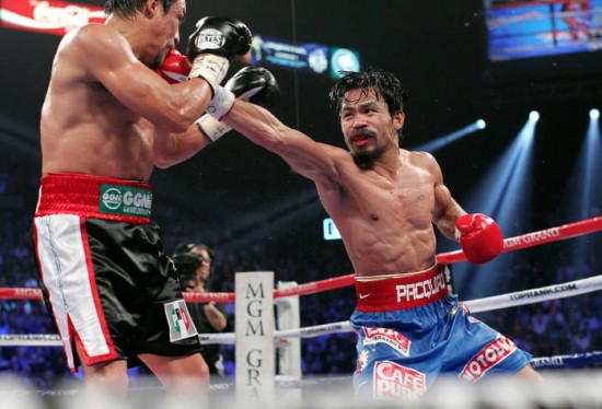 Superstar Manny Pacquiao, at right, wins a controversial 12-round majority decision over Juan Manuel Marquez (Photo Credit : Chris Farina - Top Rank, copyright 2011)