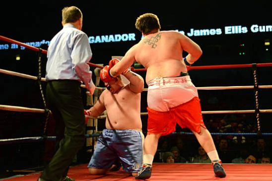 Gauch (R) throws a final hook as Curtis goes down