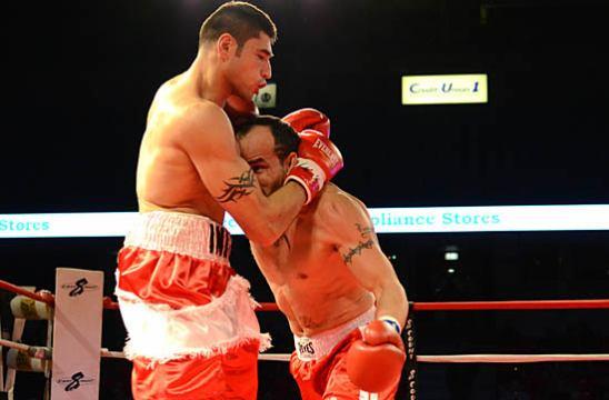 Cesar Martinez (R) swarms Mike Gavronski