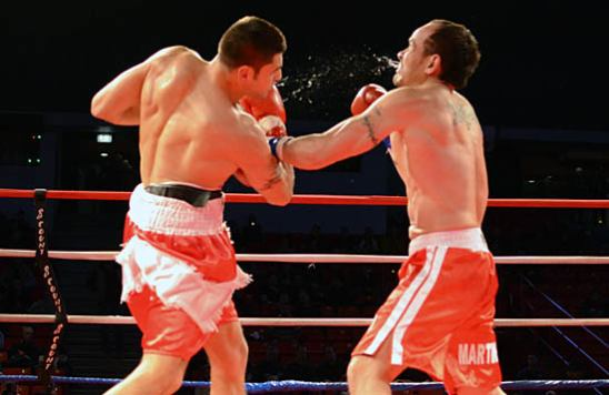Gavronski (L) lands an uppercut on Martinez