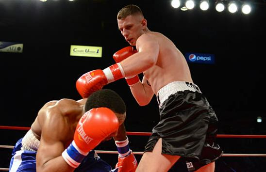 Phil Williams (L) avoids a hook from Fonfara