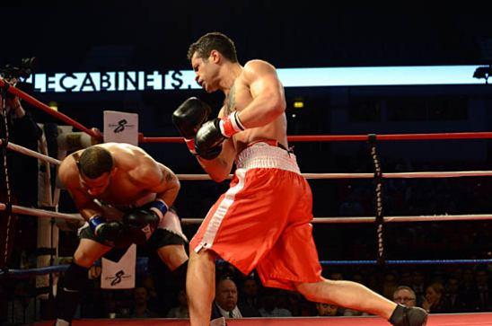 Paul Littleton (R) pummels Laguer