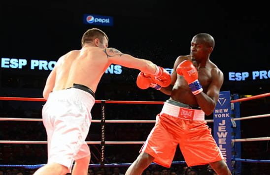 Foster Nkodo (R) stays out of Viktor Polyakov's reach
