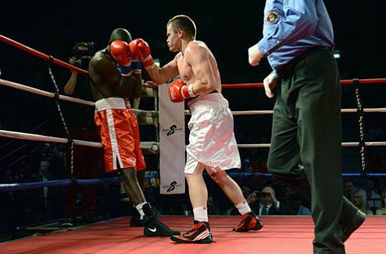 Polyakov (R) traps Nkodo on the ropes
