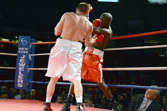 Viktor Polyakov lands a body shot on Nkodo