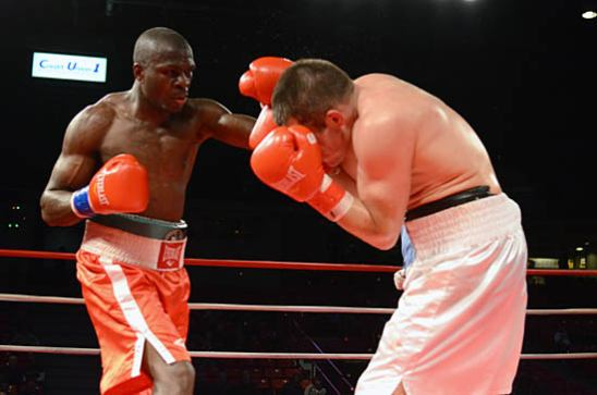 Nkodo (L) takes his turn in the final round