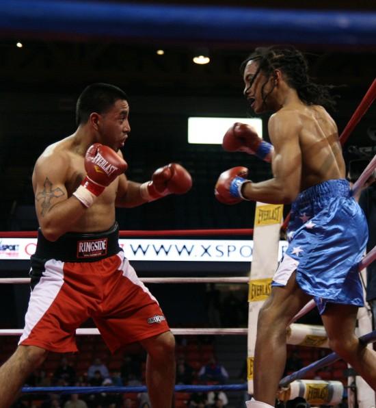 Bustamante (left) pursues Strickland.