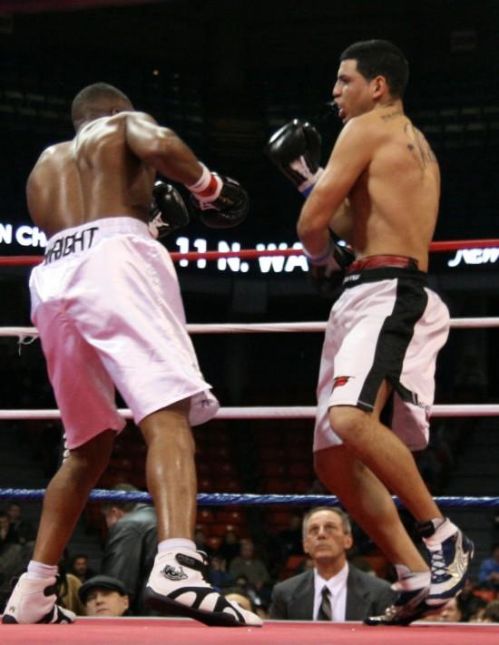 Wright (left) attacks.