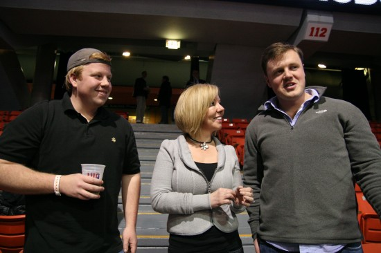 Belle Ayllon visits with her son, Ryan Shaw (right) and his friend, David Farrell in the stands.