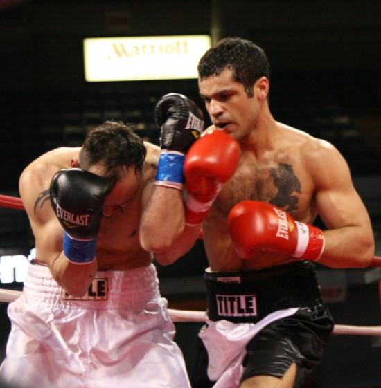 Littleton (right) attacks Martinez.