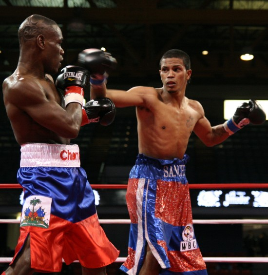 Cherry (left) pulls back from Sanchez' right jab