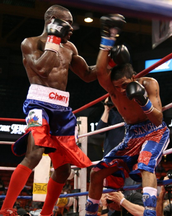Cherry (left) and Sanchez battle along the ropes.