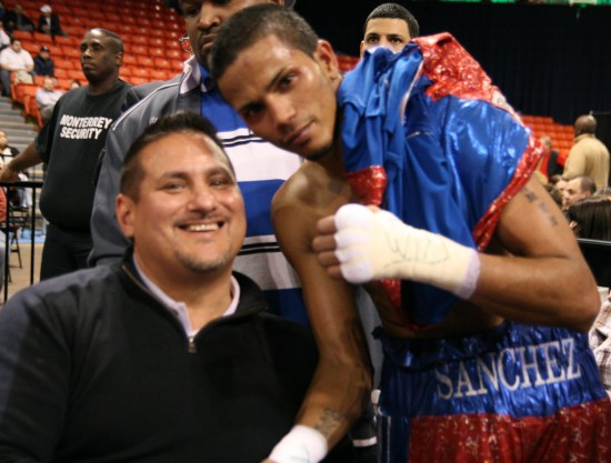 Sanchez visits with Juan C. Ayllon at ringside.