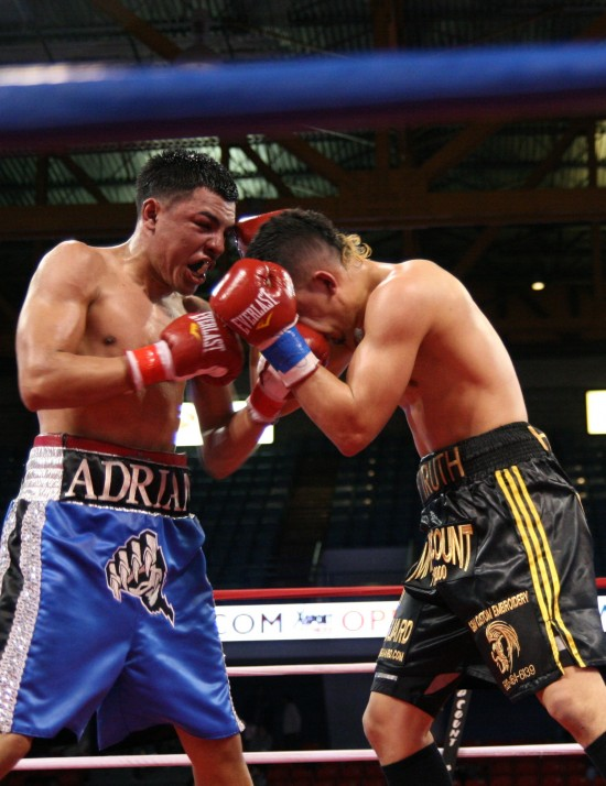 Granados catches Herrera with a short left to the chin.