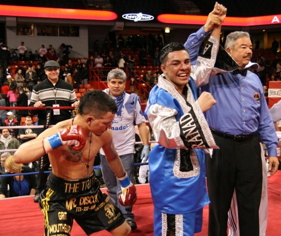 Herrera (left) creates a light moment as Granados' hand is raised by referee Gerald Scott.
