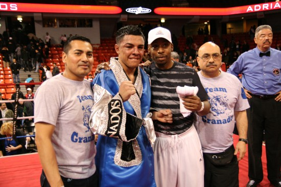 Long time Chicago trainer, George Hernandez (second from right) with Adrian Granados' team, as referee Gerald Scott looks on.