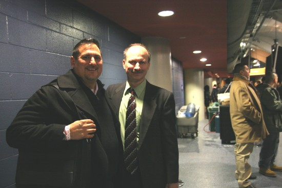 Time keeper David Morrow, who's been keeping time at pro and amateur fights since 1985, with Juan C. Ayllon.