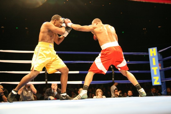 Houston (right) bounces a jab off Boose's head.