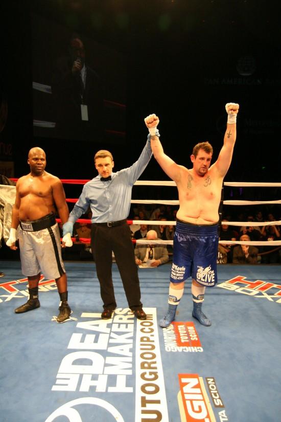 Triantafillo (right) has his right glove raised by referee Fetzer.