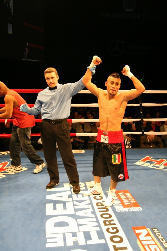 Referee Eric Fetzer raises Sergio Montes de Oca's right fist.
