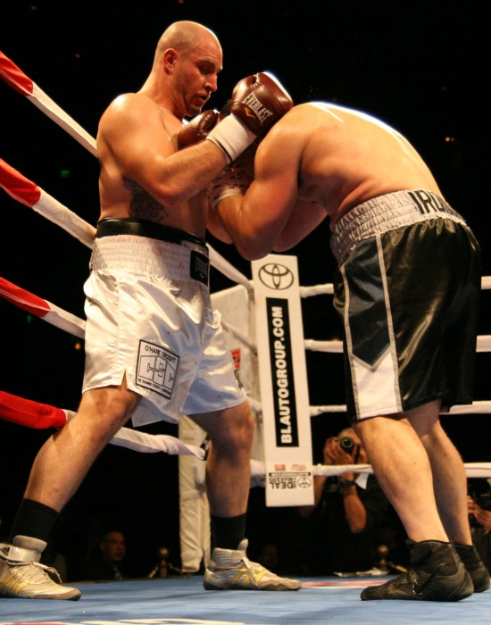 Latoria (left) slugs in close as Gutierrez covers.