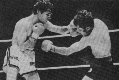 Herrera (left) hitting Rodolfo Martinez