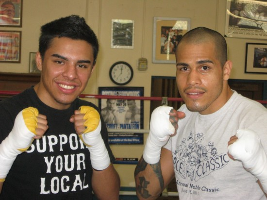 Granados (left) and Santiago mug for the camera.