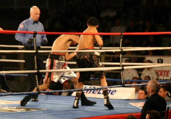 Granados (right) attacks as referee Celestino Ruiz observes.