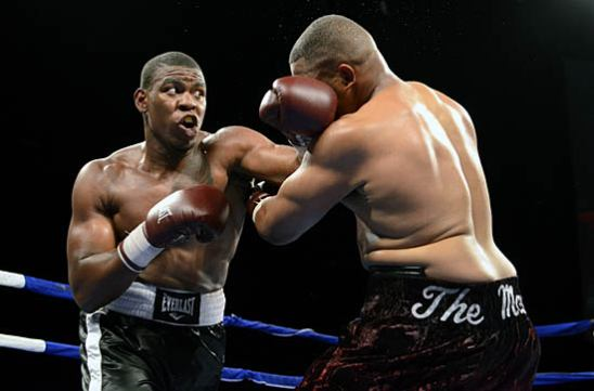 Elijah McCall (L) tries to fend off Stan Allen
